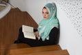 stock image of  Muslim Woman Reading Holy Islamic Book Quran