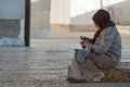 Muslim woman sarajevo bosnia and herzegovina august sits on the street holding the cell phone in her hand Stock Photo