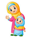 A muslim women hold her daughter head and waving hand