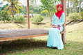 Muslimah lady wear blouse and hijab beautiful posing at garden Stock Images