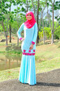 Muslimah lady wear blouse and hijab beautiful posing at garden Royalty Free Stock Images