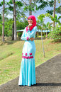 Muslimah lady wear blouse and hijab beautiful posing at garden Stock Photo
