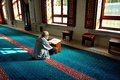 Muslims read the qur an in the mosque alone istanbul turkey january unknown man tunahan a quran istanbul turkey on january tunahan Royalty Free Stock Photography