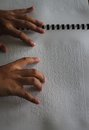 Muslims reading braille koran quran asian with visual impaired in indonesia Stock Photos
