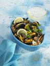 Mussels cooked in white wine, garlic and parsley Stock Photo