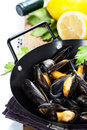 Mussels cooked with white wine sauce in a metal pot Royalty Free Stock Photography