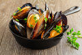 Mussels cooked in wine with parsley Royalty Free Stock Photo