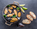 Mussels In Copper Pan On The G...