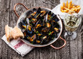 Mussels, french fries and wine Royalty Free Stock Photo