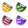 Must have stickers set of four colored with the text written on each sticker Stock Images