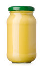 Mustard glass jar of on the white background Stock Photos