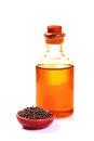 Mustard oil bottle and seeds Royalty Free Stock Photo
