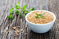 Mustard seeds and thyme in a bowl Stock Image