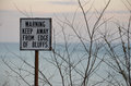 Muted color keep away from edge sign sky and lake in background Royalty Free Stock Photos