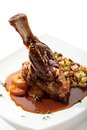 Mutton leg of with potato and vegetables Royalty Free Stock Images