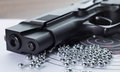 The muzzle of the air pistol and a lot of bullets closeup Royalty Free Stock Photo