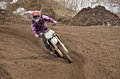 MX party rides standing cornering furrow Stock Image