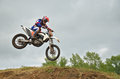 MX racer lands on the front wheel Stock Photo