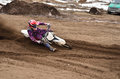 Mx racing driver at the turning in the sandy ruts biker motocross deep and large inclination motorcycle Stock Images