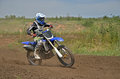 MX rider on a motorcycle in a bend Stock Photo