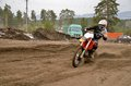 Mx rider on a motorcycle in a bend racer motorbike acceleration out track motocross Stock Image
