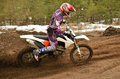 Mx rider problem in turn motocross track racer off the corner on the sandy Royalty Free Stock Images
