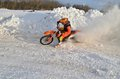 Mx winter turn with emphasis in a snowdrift racer motocross and motorcycle Stock Images