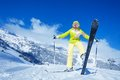 This is my best ski yong happy woman shows her standing on the mountain slope Stock Photos