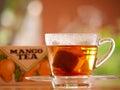 My break with mango tea take a Royalty Free Stock Photo