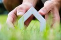 My dream house concept hand holding icon Stock Photography