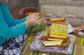 My family prepare and folding joss paper or money paper for burn Royalty Free Stock Photo
