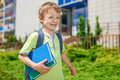 My first day in school young happy boy with books front of building Royalty Free Stock Photography