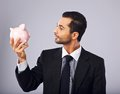 My future is looking good with my savings young manager holding a piggy bank while at it Royalty Free Stock Photo