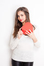 My heart cute young brunette beauty holding shaped box Stock Images