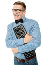 This is my keyboard no sharing cheerful nerd guy holding tightly Stock Image