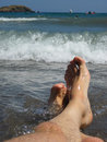 My legs in blue sea as nice relaxation background Stock Photography