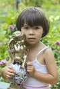 My little angel the girl holds a figurine of Royalty Free Stock Photography