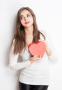 My love portrait of a beautiful dreamy young brunette woman holding heart shaped box Royalty Free Stock Photo