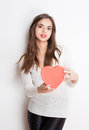 My love portrait of a beautiful dreamy young brunette woman holding heart shaped box Royalty Free Stock Photos