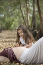 My mother a pregnant women and her daughter in a beautiful forest in autumn Stock Photography