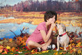 My mutt and me an attractive hispanic girl posing with her as the dog accepts her reward outside on a warm autumn day Royalty Free Stock Image