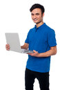 This is my new laptop young guy holding his isolated over white Royalty Free Stock Images