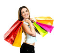 My shopping portrait young adult girl with colored bags Royalty Free Stock Photos