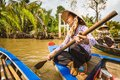 Women rowing a boat at the Mekong river