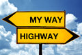 My way or the highway opposite signs two against blue sky background Stock Photo