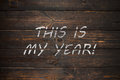 This is my year, business motivational slogan. Chalk on the wooden board