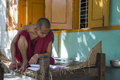 Myanmar monk s portait portrait of a reading a book in old bagan in burma nnhttp photography nationalgeographic com photography Royalty Free Stock Photos