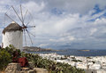 Mykonos island in greece traditional windmill over the port of Royalty Free Stock Images