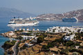 Mykonos windmills the famous at the shore of the greek cyclades island greece and two transatlantic boats Stock Photos