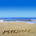 Mykonos written on sandy beach Stock Photos